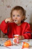 Eating yogurt Royalty Free Stock Images