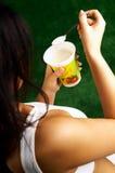 Eating Yogurt. Woman Eating Yogurt Royalty Free Stock Photo