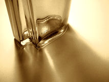 Eau de Toilette. Perfume bottle with shadow, artistical toned in retro style Stock Images