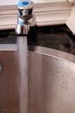 Eau du robinet Image libre de droits