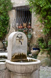 Eau Potable. Water Fountain in French Courtyard Royalty Free Stock Photography