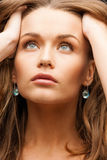 Eautiful calm woman with beautiful earrings Royalty Free Stock Photography