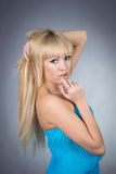 Eautiful girl in a blue dress Royalty Free Stock Photo