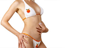 Eautiful girl in swimsuit presses to bosom ice Stock Photography