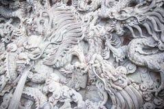 Eautiful väggskulpturer av Wenwu på den Wenwu templet i Puli den ståndsmässiga närliggande solmåne sjön royaltyfri fotografi