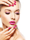 Eautiful woman face with pink makeup of eyes and nails. Stock Photography