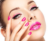 Eautiful woman face with pink makeup of eyes and nails. stock photos