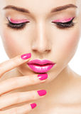 Eautiful woman face with pink makeup of eyes and nails. Royalty Free Stock Photo