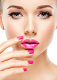 Eautiful woman face with pink makeup of eyes and nails. Royalty Free Stock Photography
