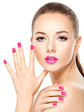 Eautiful woman face with pink makeup of eyes and nails. Stock Photo