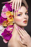 Eautiful woman with hair made of flowers and long nails Royalty Free Stock Photography