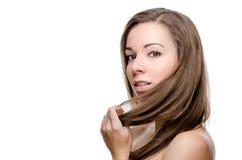 Eautiful woman touching her hair Stock Photos
