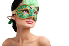 Eautiful woman wearing carnival mask Stock Images