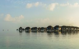 Вeautiful wooden villas, standing on stilts in the turquoise water of the Indian Ocean, Maldives. Вeautiful wooden villas, standing on stilts in the middle of Royalty Free Stock Images
