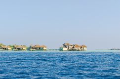 Вeautiful wooden villas, standing on stilts in the turquoise waters of the Indian Ocean, Maldives. Вeautiful wooden villas, standing on stilts in the turquoise Stock Images