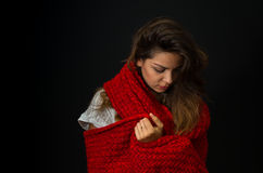 Иeautiful young girl looking down and muffling up in comforter. Portrait of beautiful young girl looking down and muffling up in comforter Stock Images