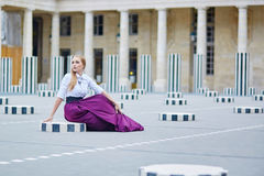 Eautiful young woman in Palais Royal in Paris Royalty Free Stock Photos