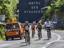 Amateur Cyclists on the Roads of Le Tour de France. Eaux-Bonnes,France- July 15th, 2011: Group of amateur cyclists going down on the road to mountain pass Stock Photo
