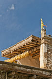 The eave of a tibetan folk house. Corns are hanged under the eave of a tibetan folk house Royalty Free Stock Images