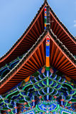 Eaves with colour painting at Lijiang Mu House Stock Images
