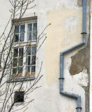 Eaves next to a window on an old house. In summer Stock Photos