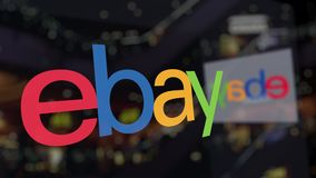 EBay Inc. logo on the glass against blurred business center. Editorial 3D rendering. EBay Inc. logo on the glass against blurred business center. Editorial 3D stock footage