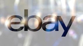 EBay Inc. logo on a glass against blurred crowd on the steet. Editorial 3D rendering. EBay Inc. logo on a glass against blurred crowd on the steet. Editorial 3D stock footage