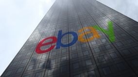 EBay Inc. logo on a skyscraper facade reflecting clouds, time lapse. Editorial 3D rendering. EBay Inc. logo on a skyscraper facade reflecting clouds, time lapse stock video footage