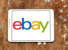 Ebay logo. Logo of ebay on samsung tablet on wooden background Royalty Free Stock Photo