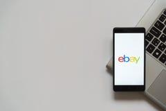 Ebay logo on smartphone screen. Bratislava, Slovakia, April 28, 2017: Ebay logo on smartphone screen placed on laptop keyboard. Empty place to write information Stock Photos