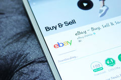 Ebay mobile app. Downloading ebay online store application from google play store on samsung tablet Stock Photos