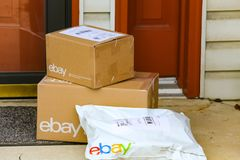 EBay Packages Delivered at Front Door. Lancaster, PA, USA - December 4, 2017: Multiple ebay packages delivered to a residential front door Stock Photography