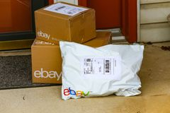 EBay Packages at Front Door. Lancaster, PA, USA - December 4, 2017: Multiple ebay packages delivered to a residential front door Stock Photography