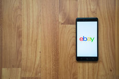 Ebay on smartphone. Los Angeles, USA, july 13, 2017: Ebay logo on smartphone screen on wooden background Royalty Free Stock Images