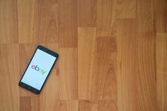 Ebay on smartphone screen. Los Angeles, USA, july 18, 2017: Ebay on smartphone screen placed on the laptop on wooden background Stock Photos
