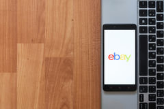 Ebay on smartphone screen. Los Angeles, USA, july 18, 2017: Ebay on smartphone screen placed on the laptop on wooden background Stock Images