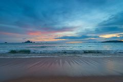 Ebb in the Andaman Sea during sunset, on the horizon beautiful m. Ountains Royalty Free Stock Photography