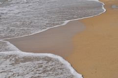 Ebb and flow by the sea Stock Photography