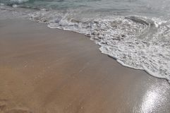 Ebb and flow by the sea Royalty Free Stock Photos