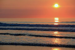 Ebb and tide of the morning& x27;s sunrise Royalty Free Stock Images