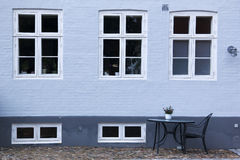 Ebeltoft street cafe blue brick wall background Stock Images
