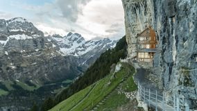Ebenalp with its famous cliff and Gasthaus inn Aescher. EBENALP, SWITZERLAND, May 2017: Ebenalp with its famous cliff inn Aescher. Ebenalp is an attractive royalty free stock photos