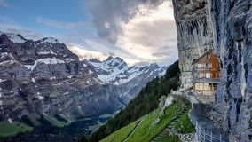 Ebenalp with its famous cliff and Gasthaus inn Aescher. EBENALP, SWITZERLAND, May 2017: Ebenalp with its famous cliff inn Aescher. Ebenalp is an attractive royalty free stock photo