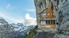 Ebenalp with its famous cliff and Gasthaus inn Aescher. EBENALP, SWITZERLAND, May 2017: Ebenalp with its famous cliff inn Aescher. Ebenalp is an attractive stock photo