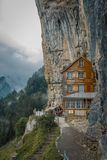 Gasthaus Aescher in Switzerland, Appenzell. EBENALP, SWITZERLAND, famous cliff inn Aescher. Appenzell is an attractive recreation region for hiking, climbing stock photography