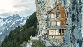 Ebenalp with its famous cliff and Gasthaus inn Aescher. royalty free stock photography