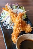 Ebi Fried shrimps. Ebi fried, deep fried shrimp, japanese cuisine server with cabbage stock photography