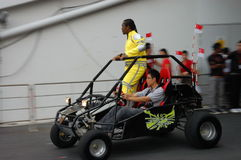 Ebi Shankara entering stage on buggy Stock Images