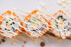 Ebiko Maki Roll Topping with Mayonnaise. Ebiko Maki Roll : Japanese Steamed Rice and Ebiko Rolled with Kani, Tamagoyaki Japanese Omlette, Avocado, Cucumber and Royalty Free Stock Photos
