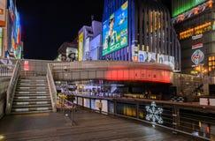 Ebisu Bridge and Illuminated billboards on the Dotonbori Canal i Stock Image